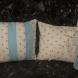 Set of cream and pink polka dot cushions.