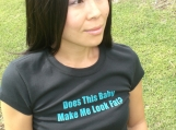 DOES THIS BABY MAKE ME LOOK FAT-maternity tee-black with teal print