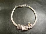 "Ladies Sterling silver charm bracelet for ""Grandma"""