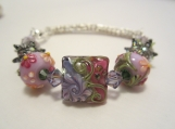 Ladies Sterling silver Viking knit bracelet with Grace Ma lampwork floral beads