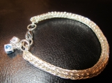 Sterling silver Viking knit bracelet with 2 metal cube charms