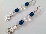 Dangle earrings with turquoise glass beads, translucent glass beads, and pewter swirl accent