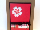 Thank you card in red and black, with a cut out flower