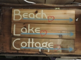 Cottage. Lake (Sea, Water etc), beach. Directional Signs