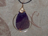 Purple agate stone pendant with gold color top coil