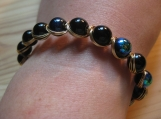 Egyptian style black bead bracelet with gold color wire