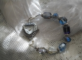 Silver heart shaped watch with blue AB crystal beaded band