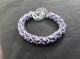 Lovely hand beaded bracelet made by hand threading each bead onto the needle then stiching them together.lilac tones for this one