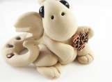 Clay tan baby dragon  sculpture figurine with RN symbol