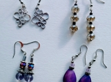 4 pairs of earrings- silver tone and light purple