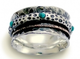 On the edge - Sterling silver integrated 9K yellow gold spinner and turquoises ring.