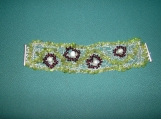 Silver wire crochetted bracelet with peridot and garnet beads
