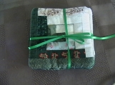 Quilted green log cabin coasters