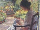 A Woman Sewing Cross Stitch Pattern