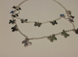 Double silver chain strand with silver butterfly charm necklace