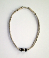 Beige and black necklace with black and silver beads