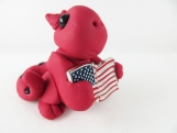 Clay red baby dragon  sculpture figurine with U S flag