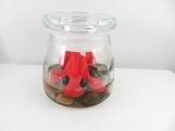 Clay  red/goldfish sculpture figurine in a jar