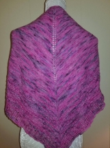 Knitted shawl in beautiful tones of pinks and purples