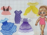 Pretty machine embroidered paper doll with 5 sets of clothes in pink suit